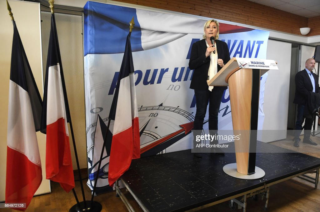 Head of the far-right Front national party Marine Le Pen gives a speech October 22, 2017 in Crach, western of France. /