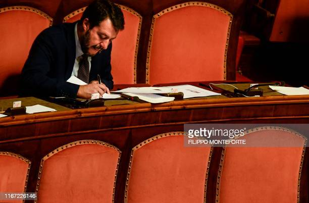 TOPSHOT Head of the farright Northern League party current Italian Senator and former Interior Minister Matteo Salvini goes through his notes prior...