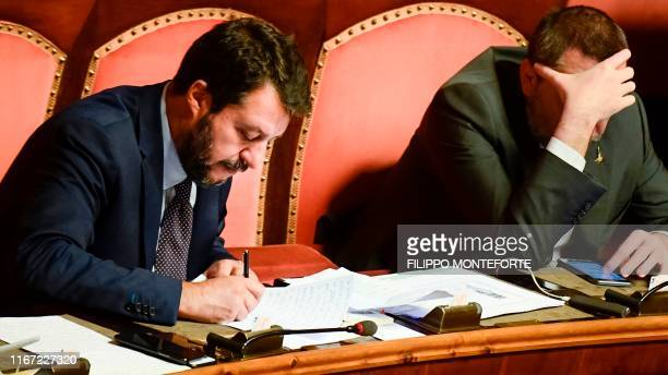 Head of the far-right Northern League party, current Italian Senator and former Interior Minister Matteo Salvini goes through his notes prior to...