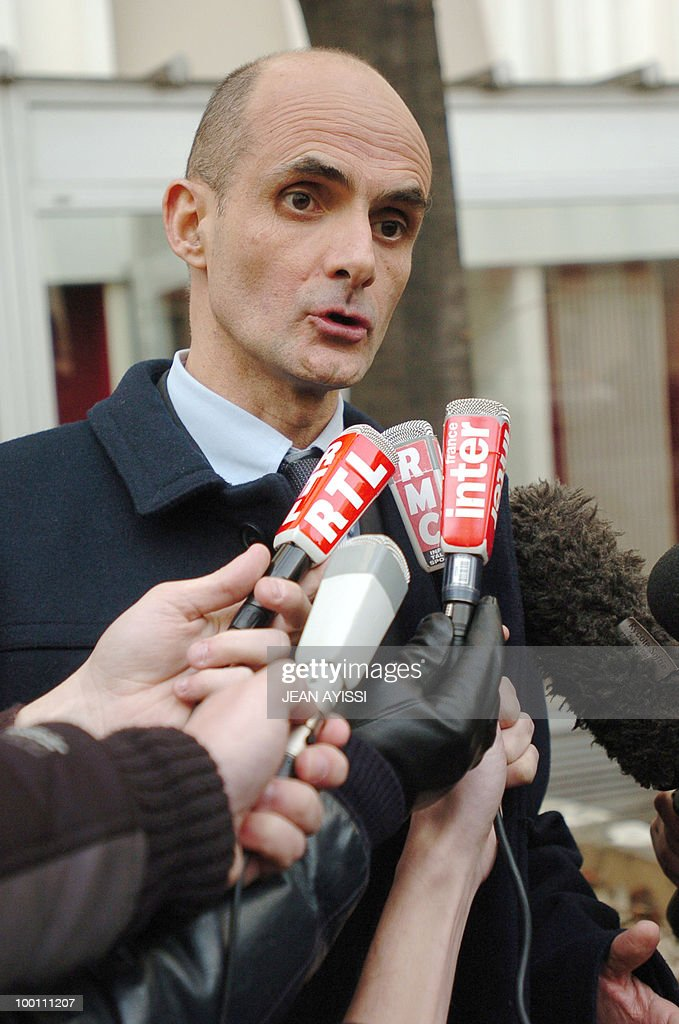 Head of the Financial Section of the Paris court, Jean-Michel Aldebert, answers to journalists as he leaves, 27 January 2008, the headquarters of the Paris police's financial brigade where Jerome Kerviel, French trader Jerome Kerviel who allegedly cost banking giant Societe Generale 4.9 billion euros in losse, was taken into police custody 26 January. The detention followed a police raid on Kerviel's apartment. The 31-year-old trader at Societe Generale turned himself in to police 26 January but had yet to be charged in the scandal over the colossal losses of 4.9 billion euros (7.15 billion dollars), the biggest in financial history.