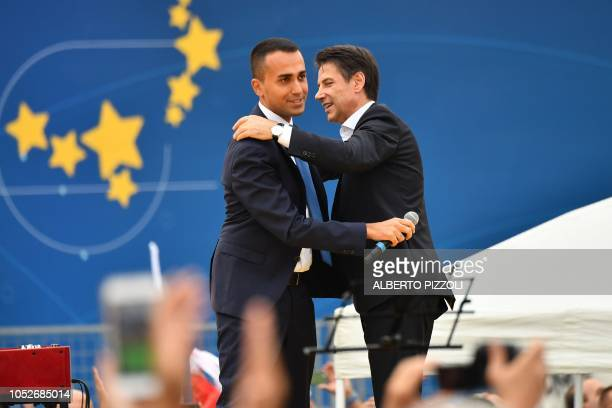 Head of the Five Star Movement Italys Labor and Industry Minister and deputy PM Luigi Di Maio and Italy's Prime Minister Giuseppe Conte embrace...