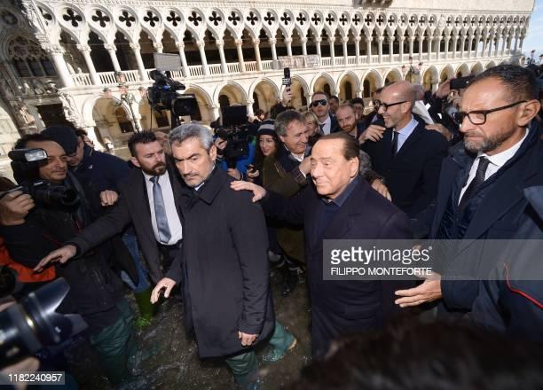 Head of the Forza Italia party former Italian prime minister Silvio Berlusconi and Venice Mayor Luigi Brugnaro assess damages across the flooded St...