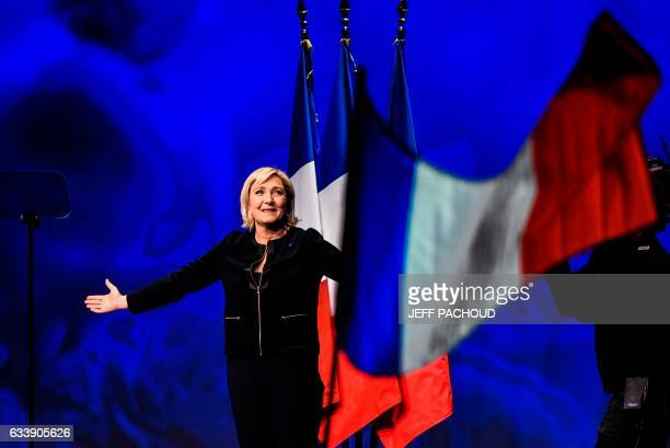 Head of the French far-right party Front national and presidential candidate Marine Le Pen arrives on stage to give a speech, on February 5 as part...