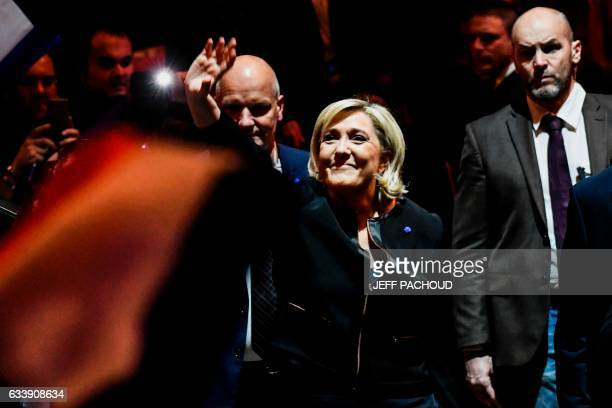TOPSHOT Head of the French farright party Front national and presidential candidate Marine Le Pen waves as she arrives to give a speech on February 5...