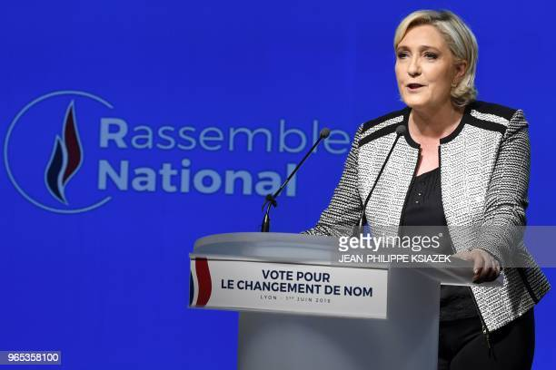 Head of the French farright party Front national Marine Le Pen speaks next to the logo of the new name of the party Rassemblement National during a...