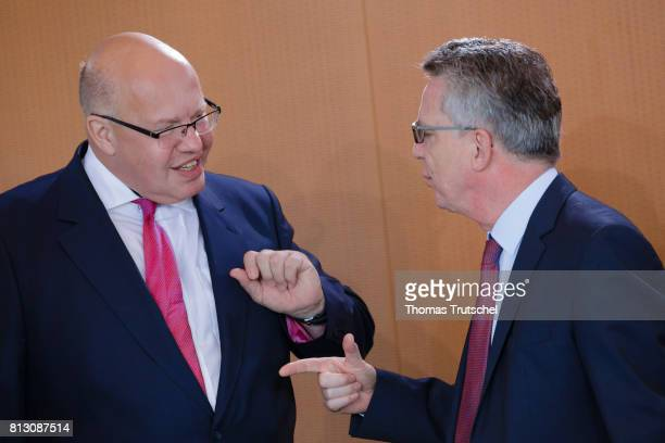 Head of the German Chancellery Peter Altmaier and German Interior Minister Thomas de Maiziere arrives for the weekly cabinet meeting at the...