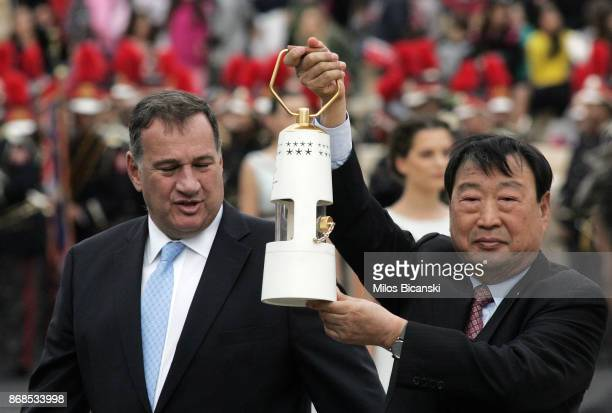 Head of the Hellenic Olympic committee Spyros Kapralos looks on as Lee Heebeom President of the PyeongChang Organising Committee for the 2018 Winter...