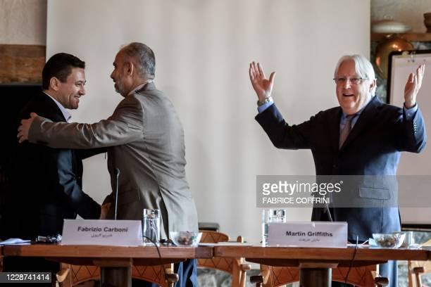 Head of the Houthi prisoner exchange committee Abdulkader al-Murtada shakes hands with Head of the Yemeni government delegation Hadi Haig next to UN...