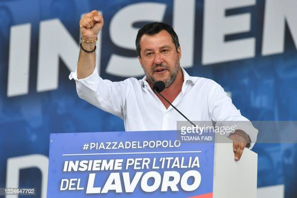 Head of the League party Matteo Salvini gestures as he delivers a speech on stage during a united rally with Brothers of Italy and Forza Italia...