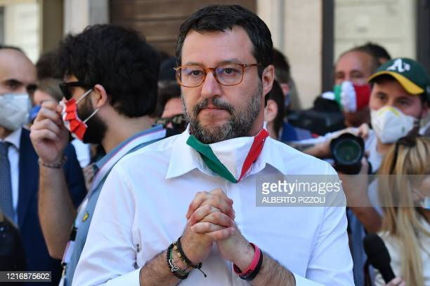 Head of the League party Matteo Salvini gestures as he marches during a rally of his party united with the Brothers of Italy party and the...