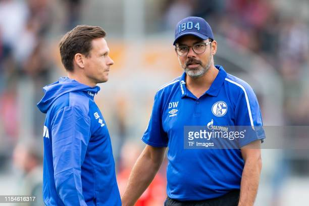 Head of the Licensing Player Department Sascha Riether of FC Schalke 04 speaks with Head coach David Wagner of FC Schalke 04 during the pre-season...