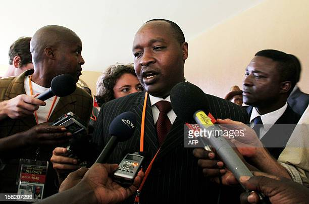 Head of the M23 Delegation Francois Rucogoza addresses journalists at peace talks in Kampala on December 11 2012 emocratic Republic of Congo's M23...
