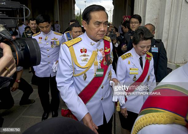 Head of the National Council for Peace and Order and army chief General Prayut ChanOCha arrives prior the opening of the National Legislative...