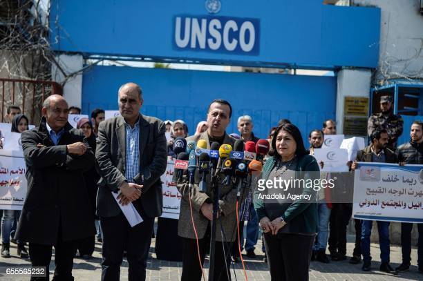 Head of the Nongovernmental organization in Gaza Muhsin Ebu Ramazan speaks to the media as a group of Palestinians gathered in front of the United...