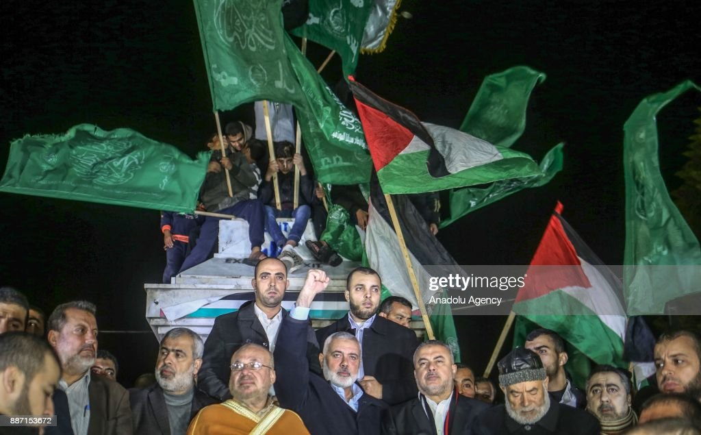 Head of the Political Bureau of Hamas, Ismail Haniyeh (5th R) attends a protest against US President Donald Trumps recognition of Jerusalem as Israels capital, in Gaza City, Gaza on December 6, 2017.