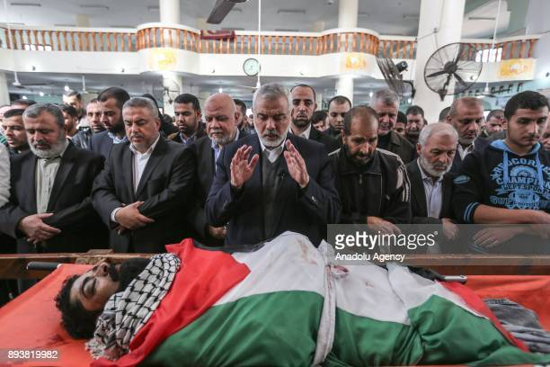 Head of the Political Bureau of Hamas Ismail Haniyeh leads the funeral prayer of 29 year old disabled Palestinian Abraham Abu Sureyya martyred during...