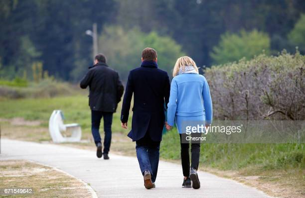 Head of the political movement En Marche! and candidate for the 2017 presidential election and his wife Brigitte Trogneux leave after posing for the...
