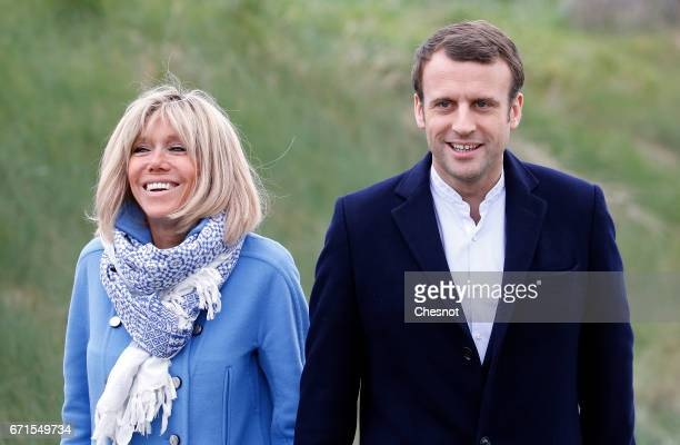 Head of the political movement En Marche and candidate for the 2017 presidential election Emmanuel Macron and his wife Brigitte Trogneux pose for a...