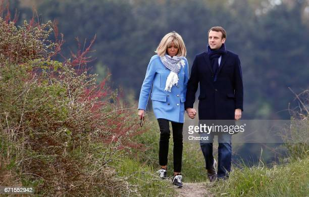 Head of the political movement En Marche! and candidate for the 2017 presidential election, Emmanuel Macron and his wife Brigitte Trogneux pose for...