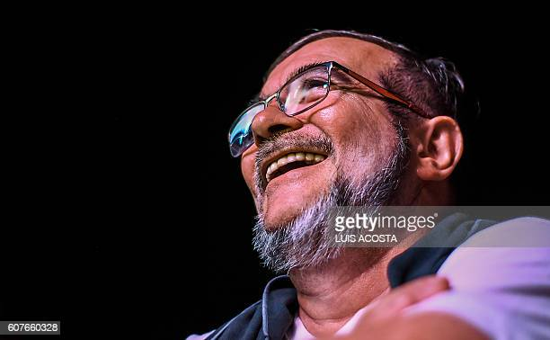 Head of the Revolutionary Armed Forces of Colombia Timoleon Jimenez aka 'Timochenko' smiles as he attends a Cultural event during the second day of...
