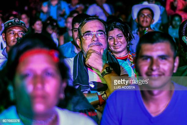 Head of the Revolutionary Armed Forces of Colombia Timoleon Jimenez aka 'Timochenko' looks on as he attends a Cultural event during the second day of...
