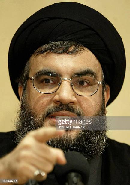 Head of the Shiite movement Hezbollah Sheikh Hassan Nasrallah gives a press conference in the southern suburb of Beirut 29 May 2004 Nasrallah pointed...