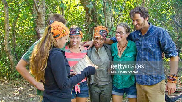 Head of the Snake Morgan McLeod reads aloud a note to Spencer Bledsoe Sarah Lacina Latasha Tasha Fox Kassandra Kass McQuillen and Jeremiah Wood...