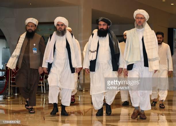 Head of the Taliban delegation Abdul Salam Hanafi , accompanied by Taliban officials Muttaqi, Shahabuddin Delawar and Abdul Latif Mansour, walks down...