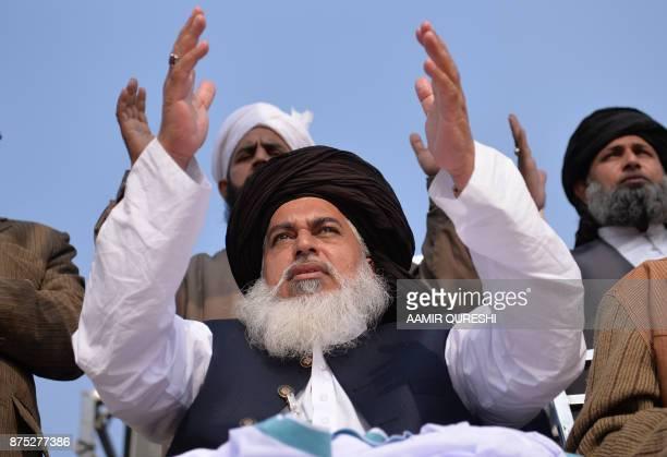 Head of the TehreekiLabaik Yah Rasool Allah Pakistan religious group Khadim Hussain Rizvi shouts religious slogans on a blocked flyover bridge during...