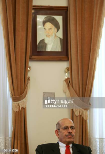 Head of the UN atomic watchdog Mohamed ElBaradei sits under a portrait of Iran's late founder of Islamic Republic Ayatollah Khomeini during his...