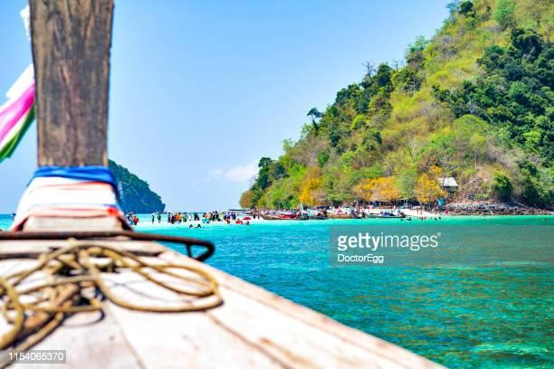 Head of Tourist Long tail Boat heading to Talay Waek Sand Bank at Ko Poda Island in Summer, Krabi, Thailand