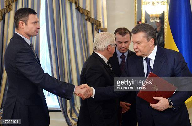 Head of Udar party Vitali Klitschko and Ukrainian President Viktor Yanukovych shake hands after signing an agreement in Kiev on February 21 2014...