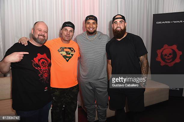 Head of XBOX Games marketing at Microsoft Aaron Greenberg Miami Dolphins player Mike Pouncey Koa Misi and guest attend the Xbox Gears Of War 4 Miami...