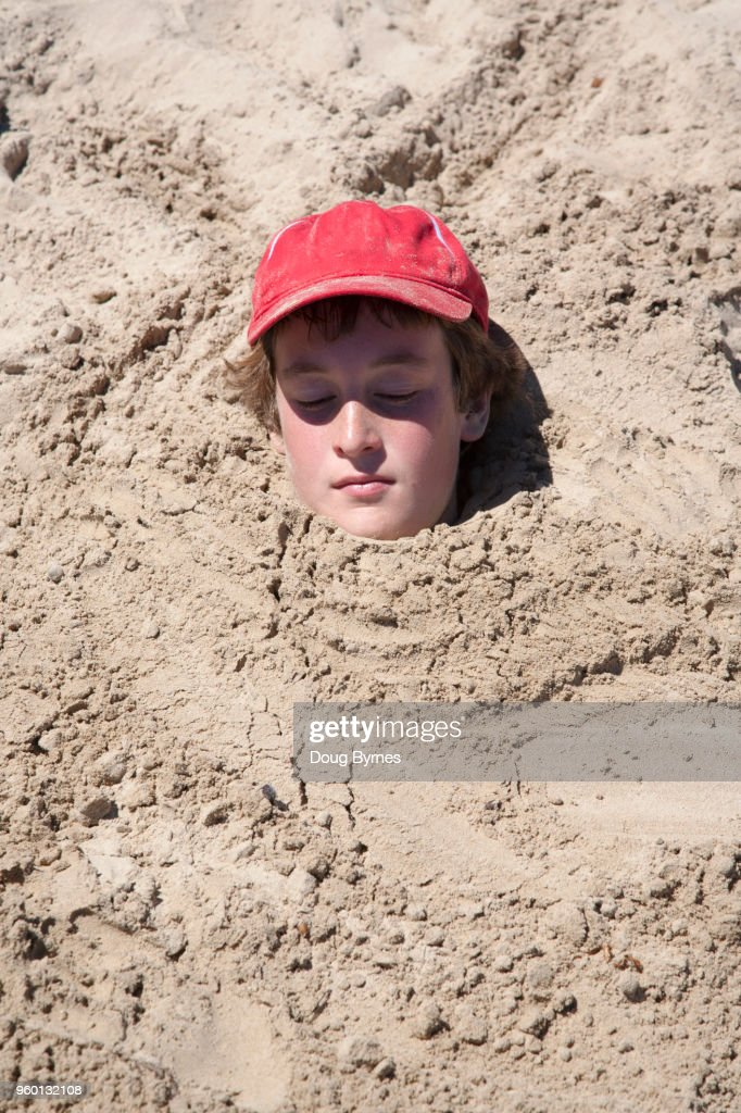 Head on the sand : Stock-Foto