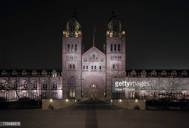Head on wide angle view of south elevation at night Natural History Museum Museum Europe United Kingdom Alfred Waterhouse