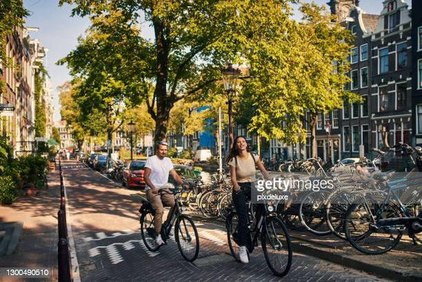 head over wheels in love! - amsterdam stock pictures, royalty-free photos & images