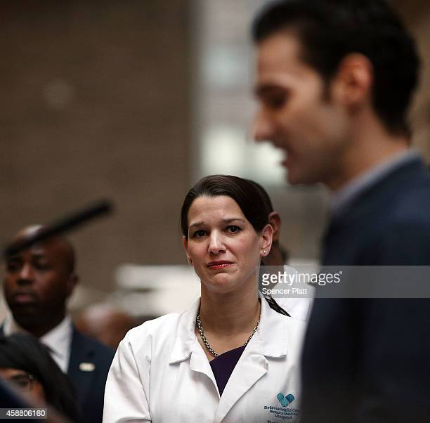 Head physician DrLaura Evans watches as Dr Craig Spencer who was diagnosed with Ebola in New York City last month speaks at a news conference at New...