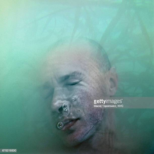 Head portrait of a man submerged in water.