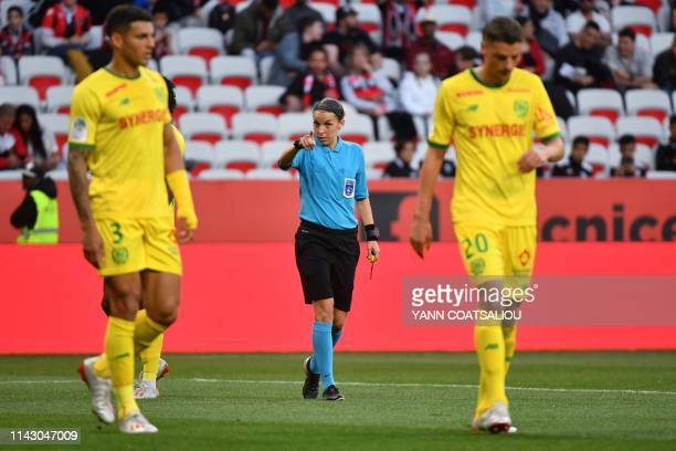 Head referee Sandrine Frappart gestures during the French L1 football match Nice vs FC Nantes on May 11 2019 at the Allianz Riviera stadium in Nice...