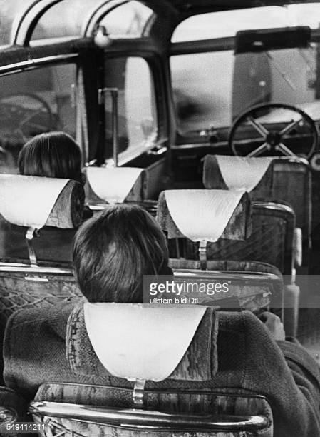 Head restraints in a travel bus - Photographer: Heinz Fremke - Published in: Berliner Morgenpost; Vintage property of ullstein bild