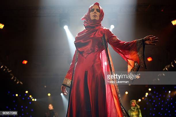 Head scarfed models walk during the catwalk fashion show of Tekbir Giyim April 20 2008 in Istanbul Turkey Tekbir Giyim is the largest design and...
