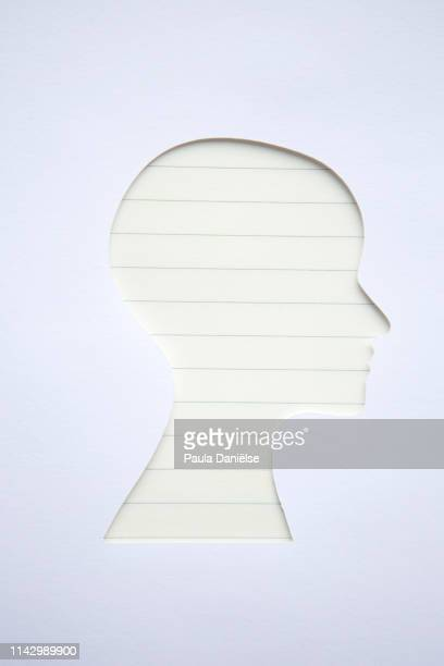 head shape with ruled paper - liniertes papier stock-fotos und bilder