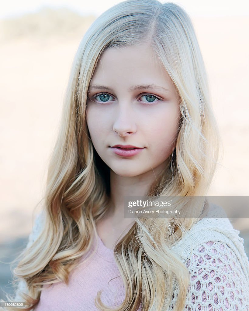 Head Shot Blond Girl With Blue Eyes Stock Photo