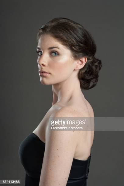 head shot in profile on a neutral, seamless background of a beautiful young woman - lolly models stock pictures, royalty-free photos & images