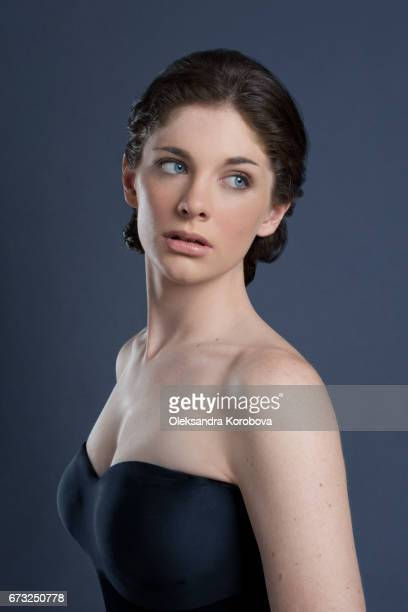 head shot in profile on a seamless background of a beautiful young woman - istock images stock pictures, royalty-free photos & images
