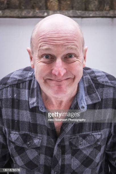 head shot of a bald man in his fifties pulling an ugly face - ugly bald man stock pictures, royalty-free photos & images