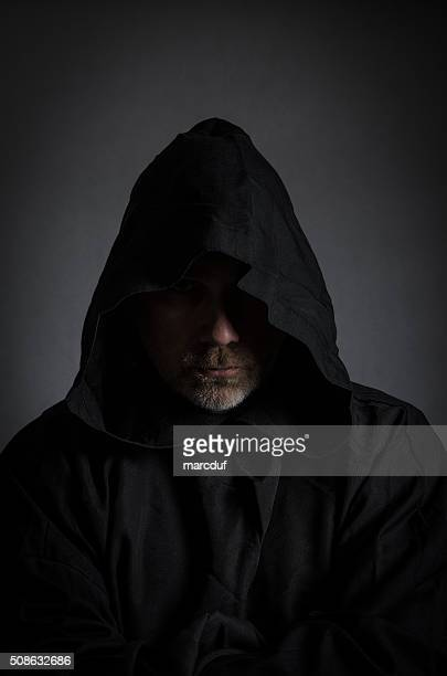 head shot of a black monk - hood clothing stock photos and pictures
