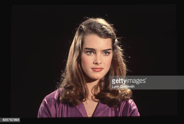 1981 Head shot of actress and model Brooke Shields in a purple blouse