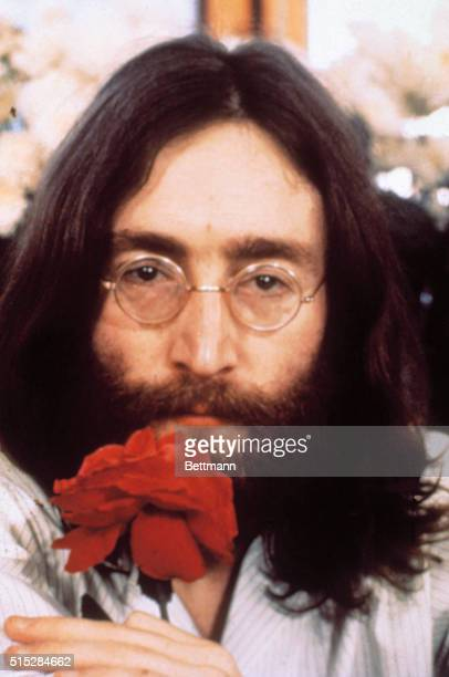 Head shot of Beatle John Lennon with rose during the Bedin for Peace demonstration
