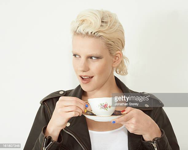 head shot of blond female holding tea cup - platillo fotografías e imágenes de stock